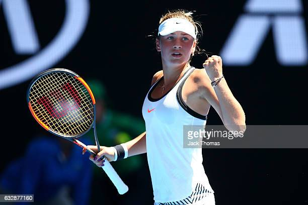 Marta Kostyuk of the Ukraine celebrates winning a point in her Junior Girls Singles Final match against Rebeka Masarova of Switzerland during the...