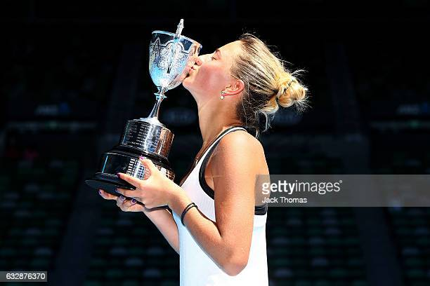 Marta Kostyuk of the Ukraine kisses the championship trophy after winning her Junior Girls Singles Final match against Rebeka Masarova of Switzerland...