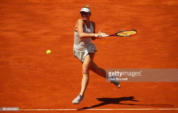 Marta Kostyuk of the Ukraine plays a forehand against Lara Arruabarrena of Spain in their first round match during day one of the Mutua Madrid Open...