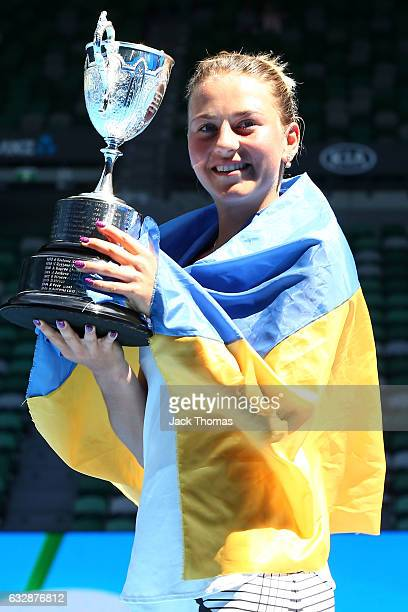Marta Kostyuk of the Ukraine poses with the championship trophy after winning her Junior Girls Singles Final match against Rebeka Masarova of...