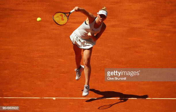 Marta Kostyuk of the Ukraine serves against Lara Arruabarrena of Spain in their first round match during day one of the Mutua Madrid Open tennis...