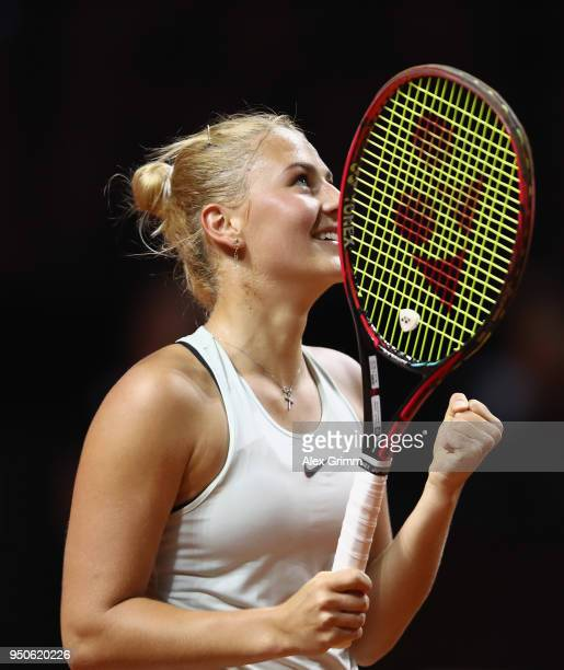 Marta Kostyuk of Ukraine celebrates after winning her match against Antonio Lottner of Germany during day 2 of the Porsche Tennis Grand Prix at...