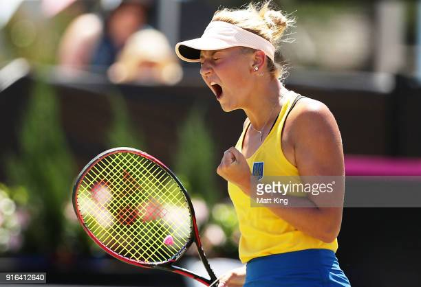 Marta Kostyuk of Ukraine celebrates winning a point in her singles match against Daria Gavrilova of Australia during the Fed Cup tie between...