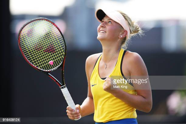 Marta Kostyuk of Ukraine celebrates winning match point in her singles match against Daria Gavrilova of Australia during the Fed Cup tie between...