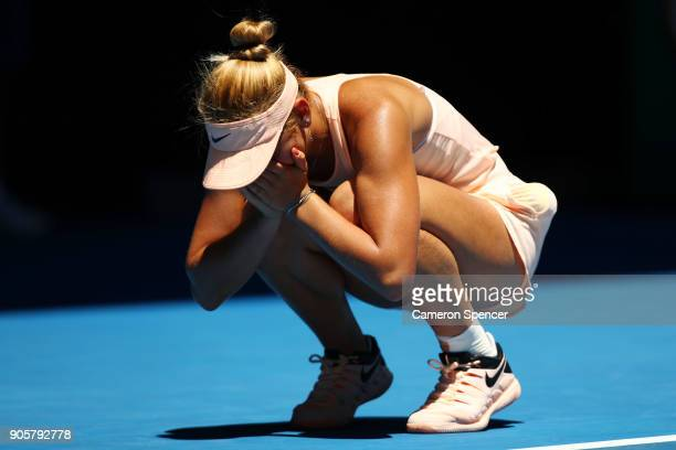 Marta Kostyuk of Ukraine celebrates winning match point in her second round match against Olivia Rogowska of Australia on day three of the 2018...