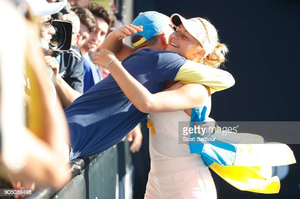 Marta Kostyuk of Ukraine is congratulated by a fan after winning her first round match against Shuai Peng of China on day one of the 2018 Australian...