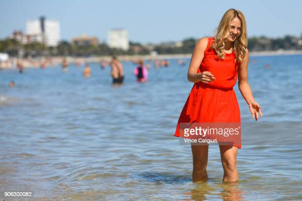 Marta Kostyuk of Ukraine making the most of the hot Melbourne weather by visiting Albert Park beach during day four of the 2018 Australian Open at...