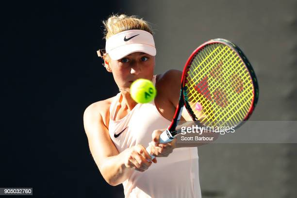 Marta Kostyuk of Ukraine plays a backhand in her first round match against Shuai Peng of China on day one of the 2018 Australian Open at Melbourne...