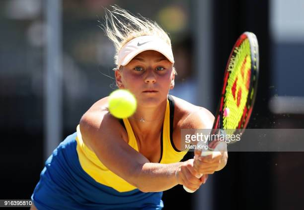 Marta Kostyuk of Ukraine plays a backhand in her singles match against Daria Gavrilova of Australia during the Fed Cup tie between Australia and the...