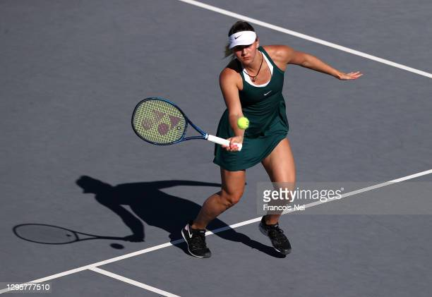 Marta Kostyuk of Ukraine plays a forehand against Sara Sorribes Tormo of Spain during her Women's Singles match on Day Six of the Abu Dhabi WTA...