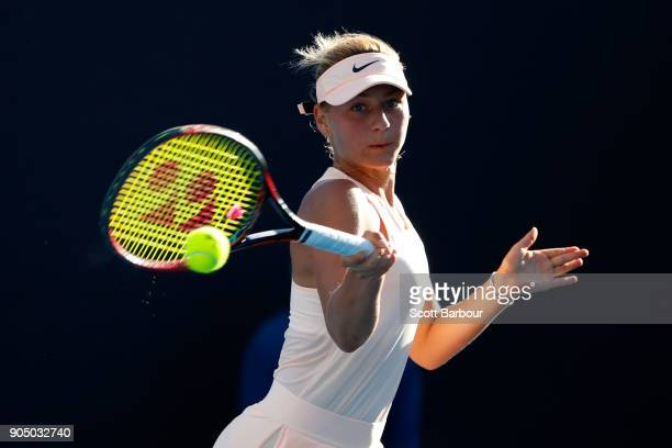 Marta Kostyuk of Ukraine plays a forehand in her first round match against Shuai Peng of China on day one of the 2018 Australian Open at Melbourne...