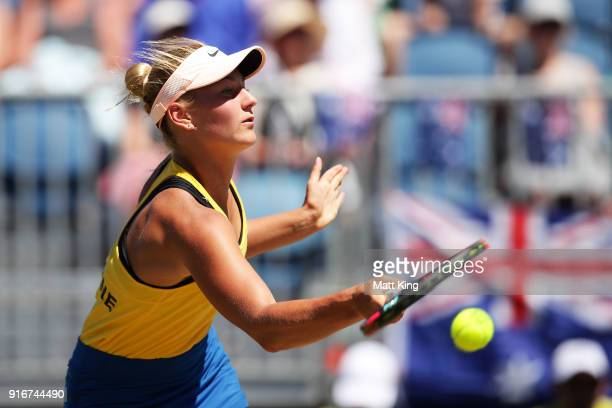 Marta Kostyuk of Ukraine plays a forehand in her singles match against Ashleigh Barty of Australia during the Fed Cup tie between Australia and the...