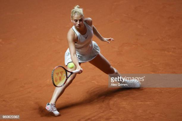 Marta Kostyuk of Ukraine plays a forehand to Antonio Lottner of Germany during day 2 of the Porsche Tennis Grand Prix at PorscheArena on April 24...