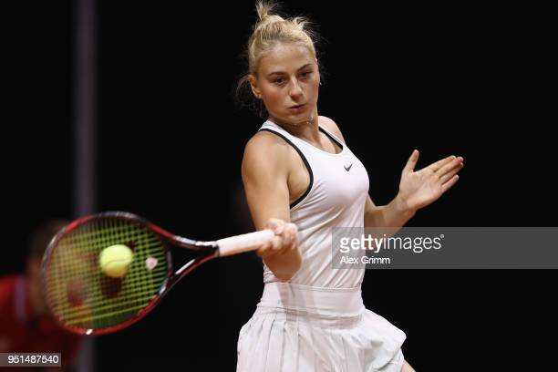 Marta Kostyuk of Ukraine plays a forehand to Caroline Garcia of France during day 4 of the Porsche Tennis Grand Prix at PorscheArena on April 26 2018...