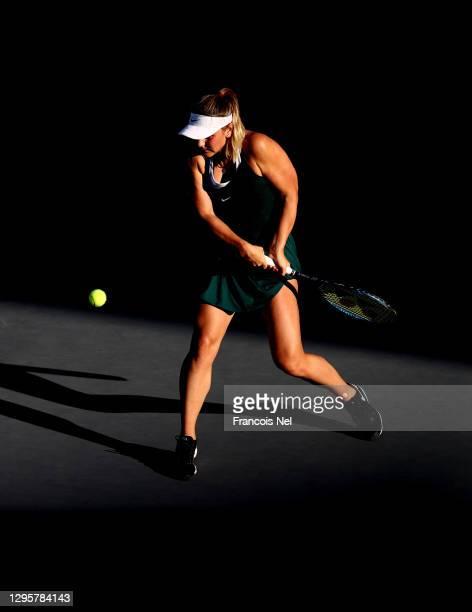 Marta Kostyuk of Ukraine plays a shot against Sara Sorribes Tormo of Spain during her Women's Singles match on Day Six of the Abu Dhabi WTA Women's...