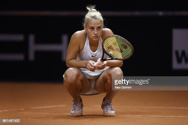 Marta Kostyuk of Ukraine reacts during her match against Caroline Garcia of France during day 4 of the Porsche Tennis Grand Prix at PorscheArena on...