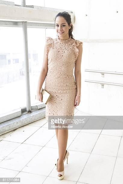 Marta Lorenzo wears Festissimo shoes Zara dress and Tous handbag during Mercedes Benz Fashion Week at Ifema on February 19 2016 in Madrid Spain