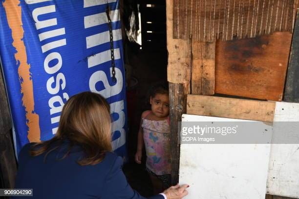 Marta Lucía Ramírez seen speaking to a little girl inside her home as she visit the inhabitants of a shantytown in Caracas The Columbian presidential...