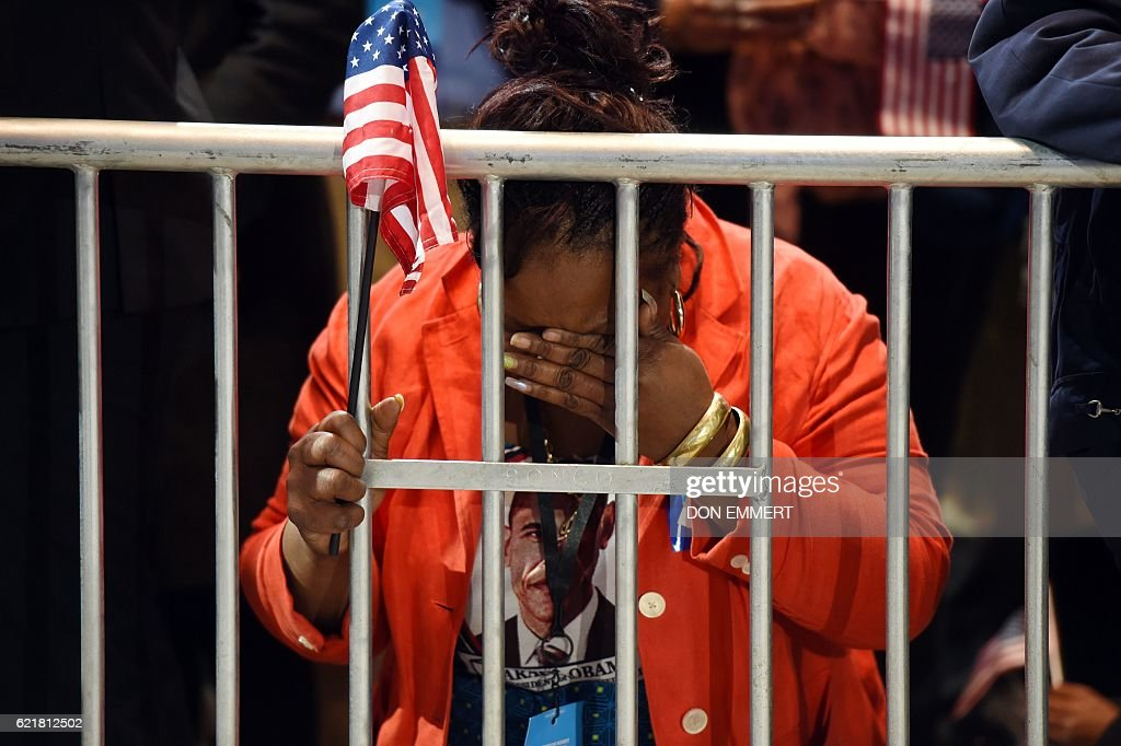 Marta Lunez, supporter of US Democratic presidential nominee Hillary Clinton, reacts to elections results during election night at the Jacob K. Javits Convention Center in New York on November 8, 2016. / AFP / DON