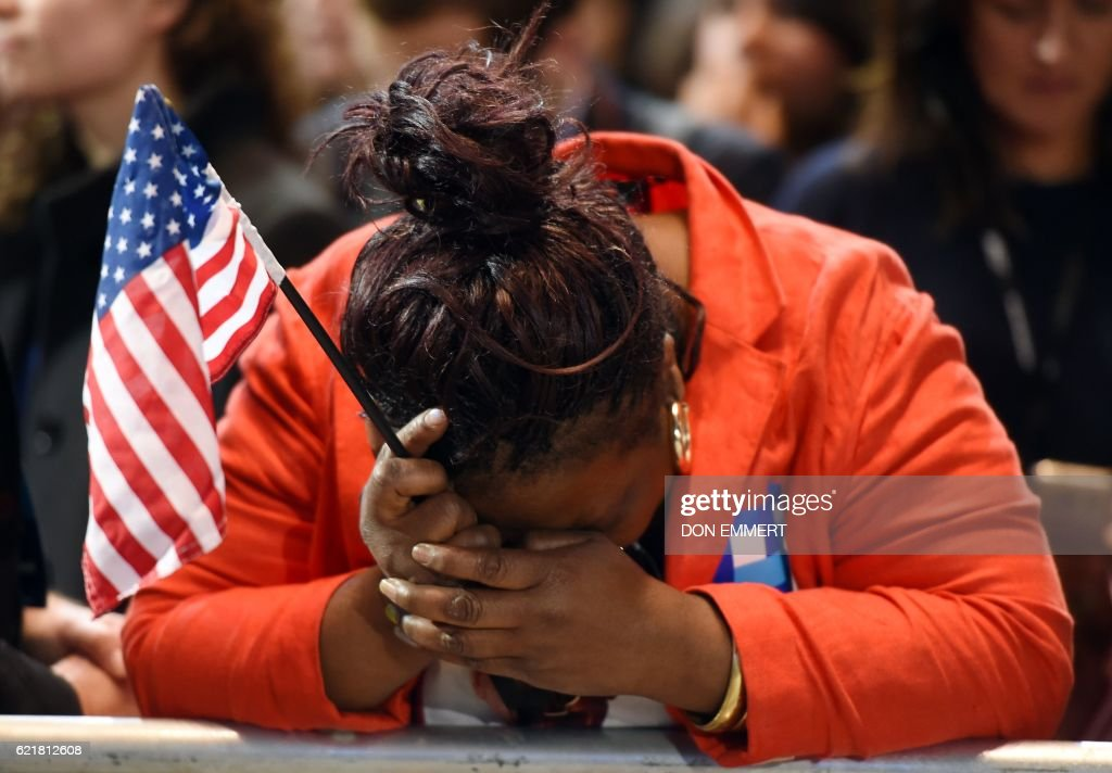 TOPSHOT - Marta Lunez, supporter of US Democratic presidential nominee Hillary Clinton, reacts to elections results during election night at the Jacob K. Javits Convention Center in New York on November 8, 2016. /