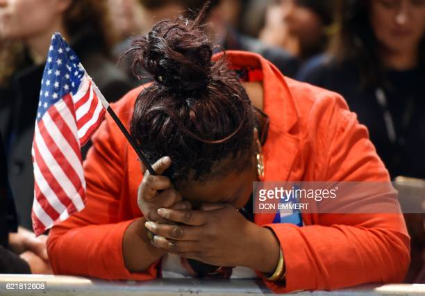 TOPSHOT Marta Lunez supporter of US Democratic presidential nominee Hillary Clinton reacts to elections results during election night at the Jacob K...