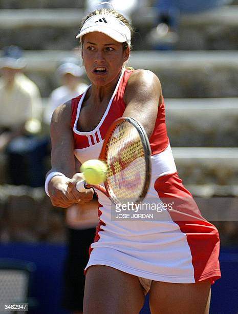 Marta Marrero of Spain returns the ball to Swiss Patty Schnyder during the first match of the Federation cup in La Manga Murcia 24 April 2004 AFP...