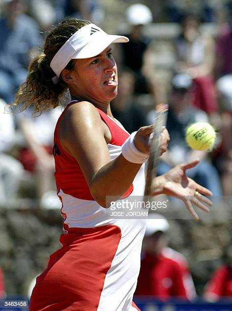 Marta Marrero of Spain returns the ball to Swiss Patty Schnyder during the first match of the Federation cup in La Manga Murcia 24 April 2004...