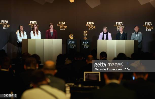 Marta of Brazil Alex Morgan and Abby Wambach of the USA Bruno Bini of France Pia Sundhage of Sweden and Norio Sasaki of Japan during the Press...