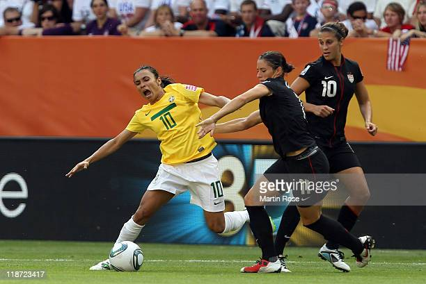 Marta of Brazil and Alex Krieger of USA battle for the ball during the FIFA Women's World Cup 2011 Quarter Final match between Brazil and USA at...