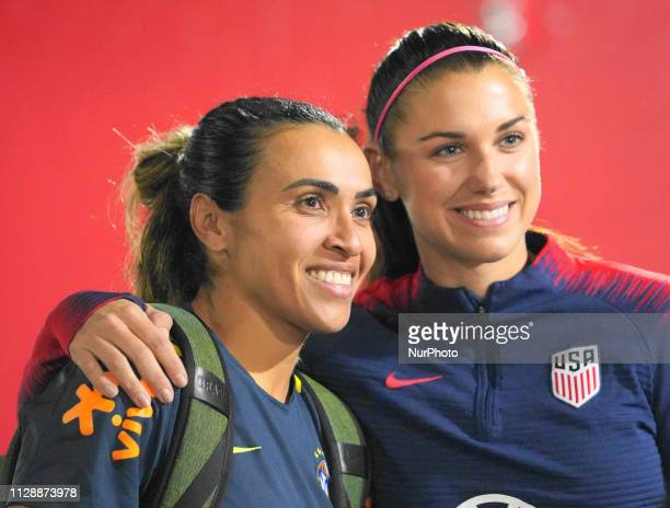 Marta of Brazil and Alex Morgan of The United States club teammates meet each other during the SheBelieves Cup training and media availability...