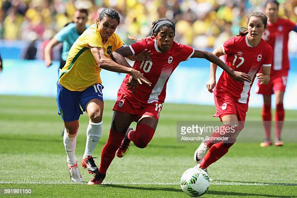 Marta of Brazil and Ashley Lawrence of Canada challenge for the ball during the Women's Olympic Football Bronze Medal match between Brazil and Canada...