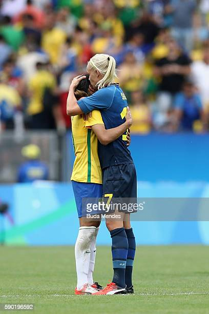 Marta of Brazil and Caroline Seger of Sweden embrace following the Women's Football Semi Final between Brazil and Sweden on Day 11 of the Rio 2016...