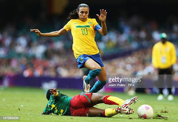 Marta of Brazil and Christine Manie of Cameroon compete for the ball during Women's Group E match between Cameroon and Brazil on Day 2 of the London...
