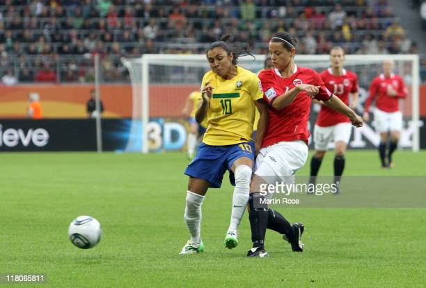 Marta of Brazil and Nora Holstad Berge of Norway battle for the ball during the FIFA Women's World Cup 2011 Group D match between Brazil and Norway...