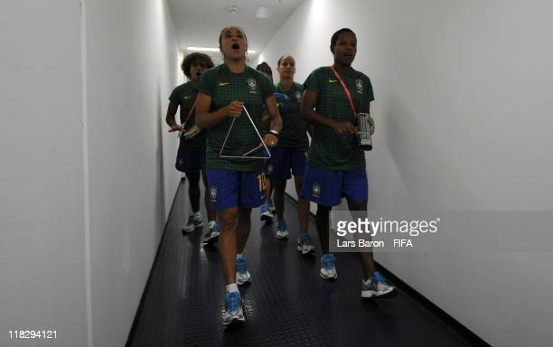 Marta of Brazil and other team mates attend the stadium and play musical instruments prior to the FIFA Women's World Cup 2011 Group D match between...