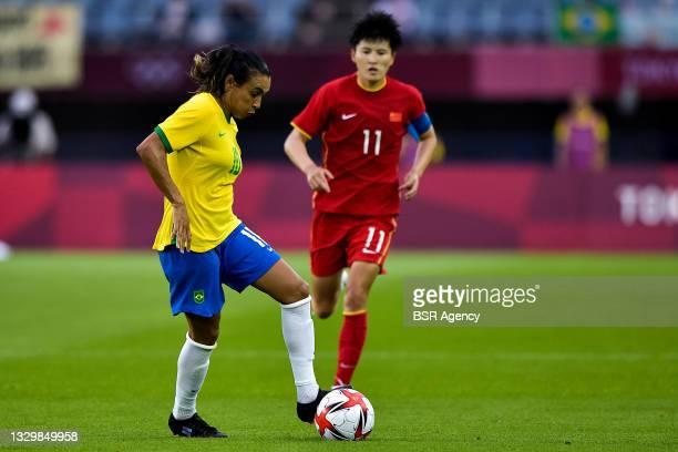 Marta of Brazil and Shanshan Wang of China during the Tokyo 2020 Olympic Football Tournament match between China and Brazil at Miyagi Stadium on July...
