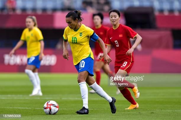 Marta of Brazil and Siwen Miao of China during the Tokyo 2020 Olympic Football Tournament match between China and Brazil at Miyagi Stadium on July...