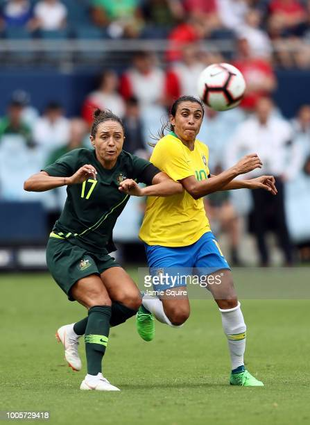 Marta of Brazil battles Kyah Simon of Australia for the ball during their Tournament of Nations match at Children's Mercy Park on July 26 2018 in...