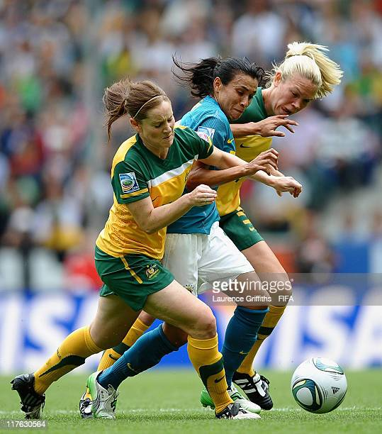 Marta of Brazil battles with Collette McCallum and Kim Carroll of Australia during the FIFA Women's World Cup 2011 Group D match between Brazil and...