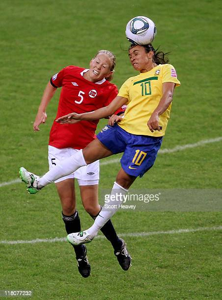 Marta of Brazil beats Marita Skammelsrud Lund of Norway in the air during the FIFA Women's World Cup 2011 Group D match between Brazil and Norway at...