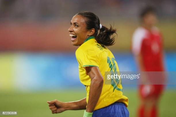 Marta of Brazil celebrates after her teammate Daniela scored against North Korea during the 2008 Beijing Olympic Games first round Group F women's...