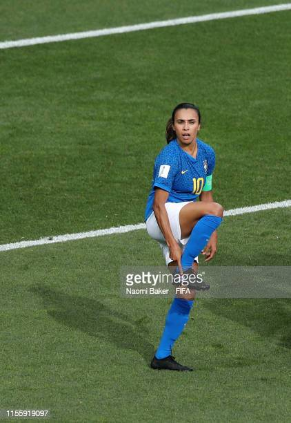Marta of Brazil celebrates after scoring her sides first goal from the penalty spot while pointing to her shoe in support of the Go Equal campaign...