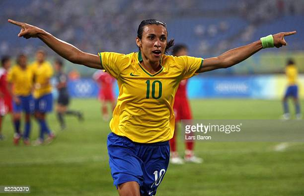 Marta of Brazil celebrates after scoring the second goal during the Women's First Round Group F match between Brazil and North Korea in Shenyang...