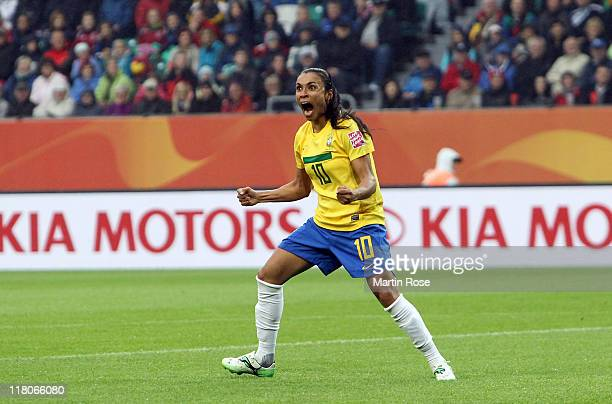 Marta of Brazil celebrates after she scores her team's openin goal during the FIFA Women's World Cup 2011 Group D match between Brazil and Norway at...
