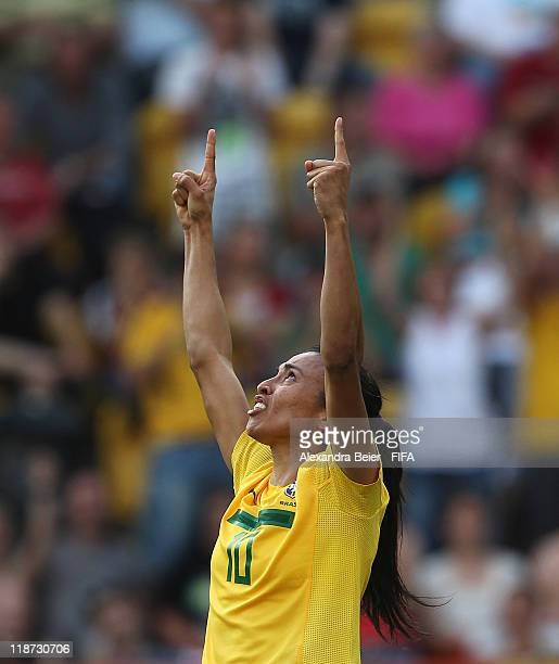 Marta of Brazil celebrates her second goal during the FIFA Women's World Cup quarter final match between Brazil and USA at RudolfHarbig stadium on...