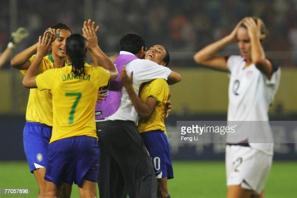Marta of Brazil celebrates the winning with her head coach after the Womens World Cup 2007 Semi Final match between USA and Brazil at Hangzhou Dragon...