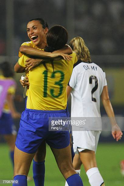 Marta of Brazil celebrates the winning with Monica after the Womens World Cup 2007 Semi Final match between USA and Brazil at Hangzhou Dragon Stadium...