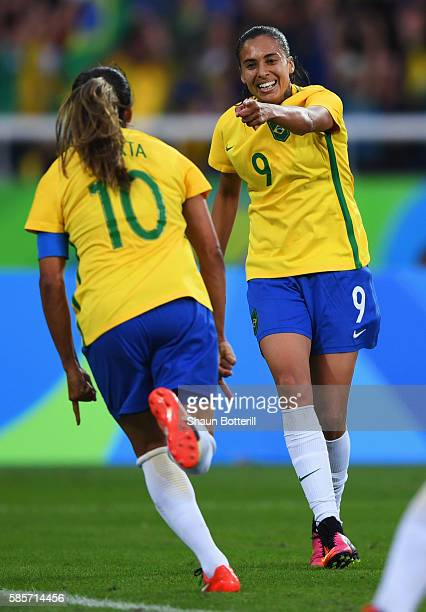 Marta of Brazil celebrates with Andressa Alves as she scorers their second goal during the Women's Group E first round match between Brazil and China...