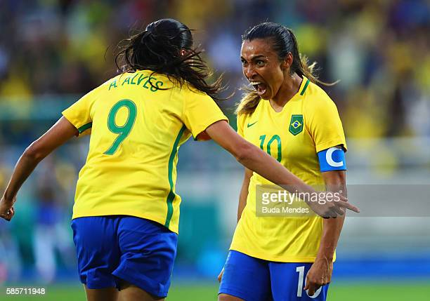 Marta of Brazil celebrates with Andressa Alves as she scores their second goal during the Women's Group E first round match between Brazil and China...