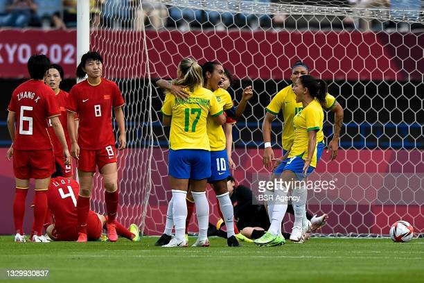Marta of Brazil celebrates with Andressinha of Brazil after scoring her sides first goal during the Tokyo 2020 Olympic Football Tournament match...